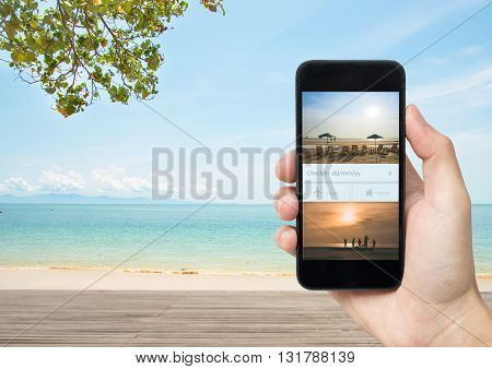 hand holding smartphone with travel weekend big sale promotion discount deal last summer.