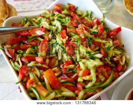 Classic famous Israeli salad made of freshly cut vegetables
