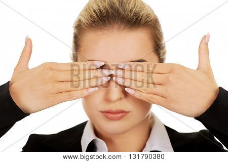 Beautiful woman covering her eyes with her hands. See no evil concept