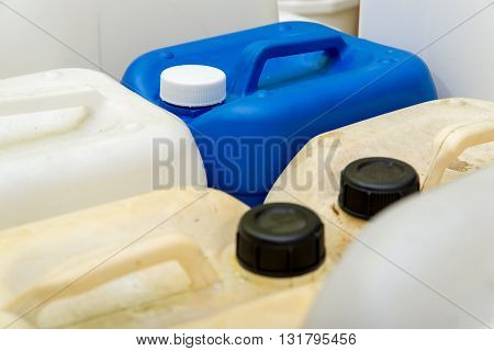 Blue and white plastic chemical containers for use in industrial chemical manufacturing.