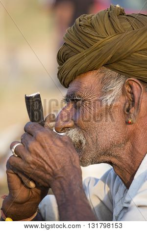 PUSHKAR INDIA - OCTOBER 27 2014: Unidentified Indian man attended the annual Pushkar Camel Mela. This fair is the largest camel trading fair in the world.