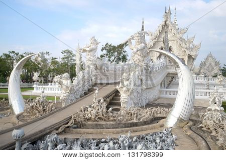 CHIANG RAI, THAILAND - JANUARY 14, 2014: At the entrance to the White Temple (Wat Rong Khun) a cloudy morning. Religious landmark of the city Chiang Rai, Thailand