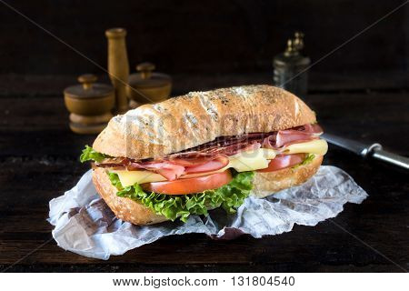 Photos of rich sandwich on rustic background