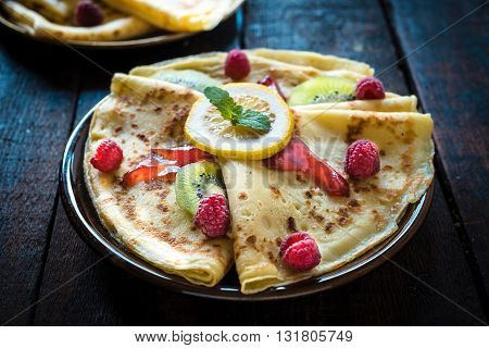 Photos of sweet pancakes on rustic background