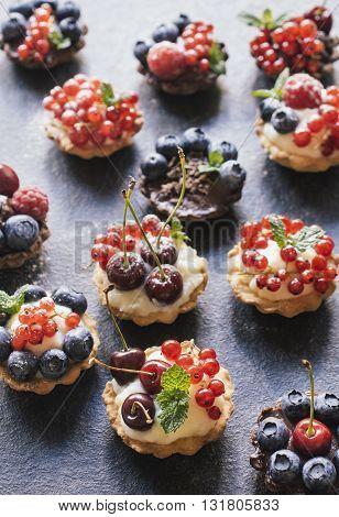 Photos of sweet tarts cake on rustic background