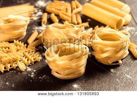 Photos of tagliatelle pasta on rustic background