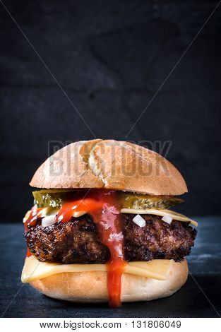 Photos of tasty burger on rustic background