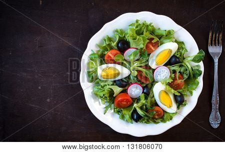 Photos of tasty salad on rustic background