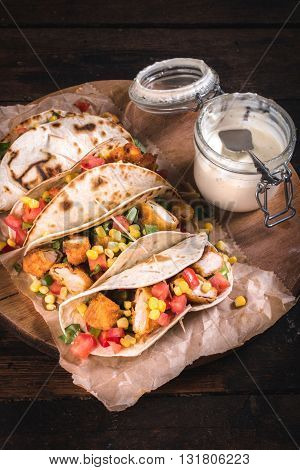 Photos of tortilla wrap on rustic background