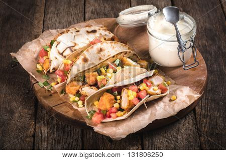 Photos of tortilla wraps on rustic background