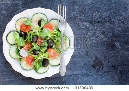 Photos of vegetarian salad on rustic background