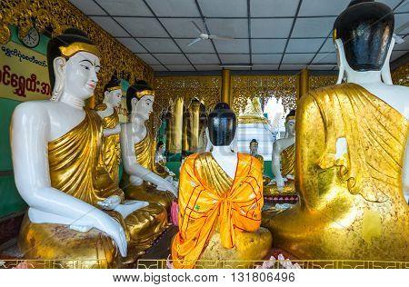 Yangon,  Myanmar - January 9, 2012:  Buddha statues in the Swedagon Pagoda.