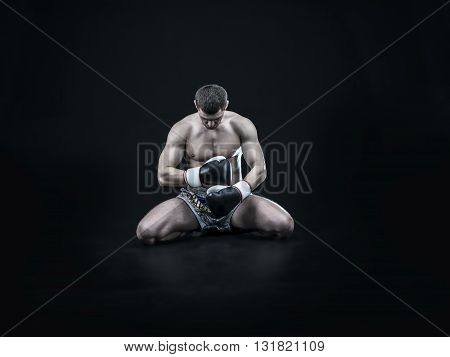 Professional caucasian muay thai fighter isolated on black background