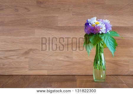 vase with hand picked flowers on wood for mother day greeting card