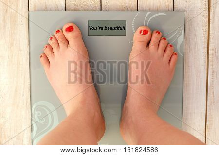 Feet On Scales With Text You Look Beautiful On The Wooden Background