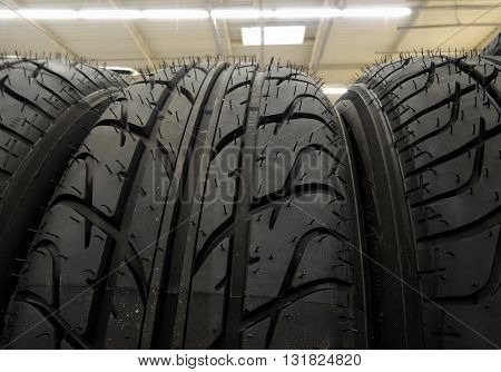 New tires on the shelf at car parts store stock photo