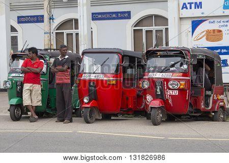 HIKKADUWA SRI LANKA - NOVEMBER 11 2014: Auto rickshaw or tuk-tuk on the street of Hikkaduwa. Most tuk-tuks in Sri Lanka are a slightly modified Indian Bajaj model imported from India.