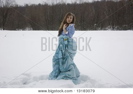 Girl sleeping in snow