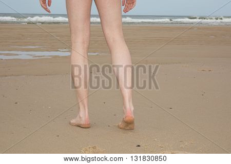 Nude Legs Of A Man Naturist On Beach
