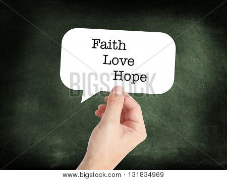 Faith, love, hope written on a speechbubble
