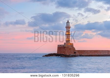 Lighthouse in old harbour of Chania at dawn, Crete, Greece