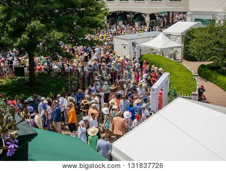 Louisville Kentucky: May 7 2016: Walking around churchill downs on Derby Day among finely dressed crowds