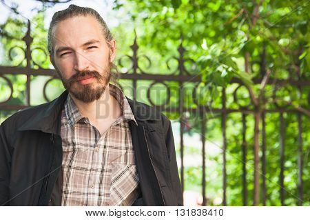 Young Bearded Asian Man In Summer Park, Portrait