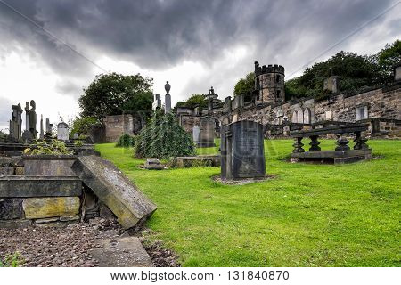 Edinburgh, United Kingdom - August 15, 2014: The Old Calton burial ground under dramatic sky. Located at Calton Hill, this burial ground, opened in 1718, is the resting place of several notable Scots.