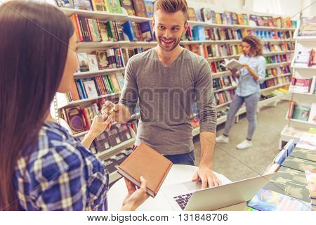 Man With Credit Card At The Bookshop
