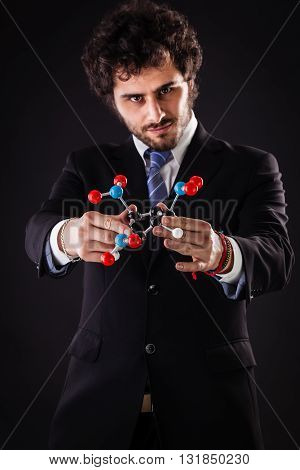 Businessman Holding A Tnt Molecular Structure