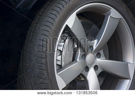 Wheel closeup with brake disc and caliper alloy wheels