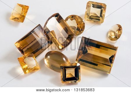 Several yellow citrine stones with different types of cutting