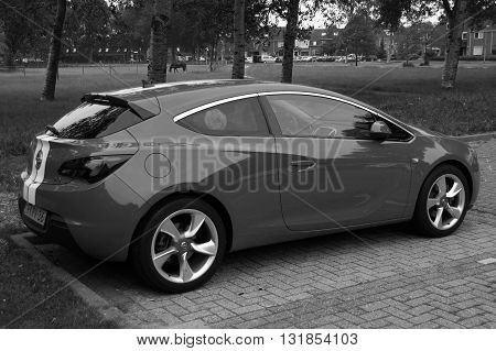 Almere, The Netherlands - May 29, 2016: Opel Astra GTC parked on a public parking lot in the city of Almere.