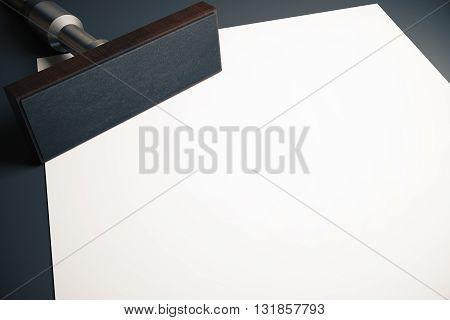 Rectangular stamper and blank paper sheet on dark desktop. Mock up 3D Rendering