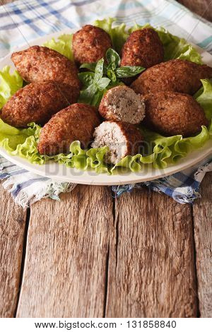 Hot Kibbeh Meatballs With Bulgur And Pine Nuts Closeup. Vertical