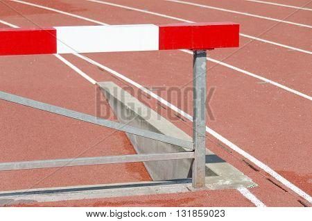 sports athletics barrier red and white around stadium