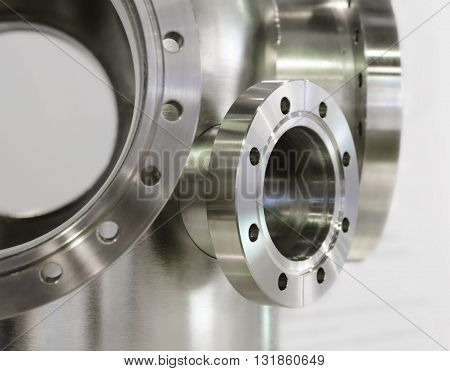 Several Thick Metal Flange Mounted On The Steel Casing.