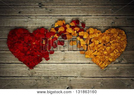 Two rose petal hearts connection on wood background. Romantic relationship concept. Attachment and love symbol giving and exchange of feelings and emotions of love.