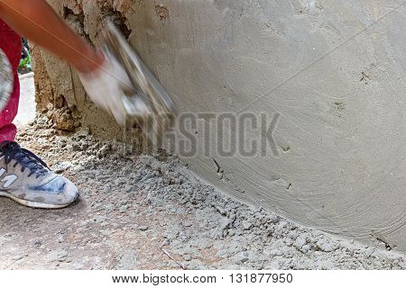 Master produces grout plaster using a grater