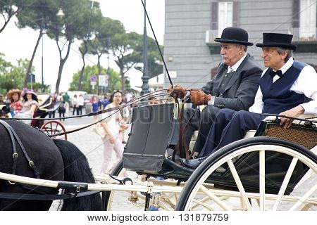 Naples Italy. May 29 2016: Participants of the parade of carriages with actors in costumes to commemorate the three hundredth anniversary of the birth of Charles of Spain who was King of Naples
