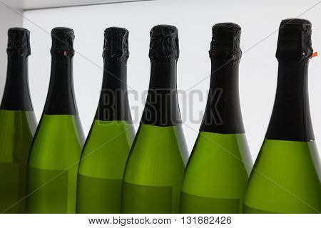 White Wine's Bottles In Line, Inside Green Glass