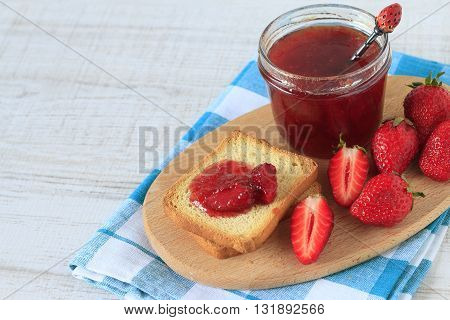 Homemade strawberry jam and toast bread on a table