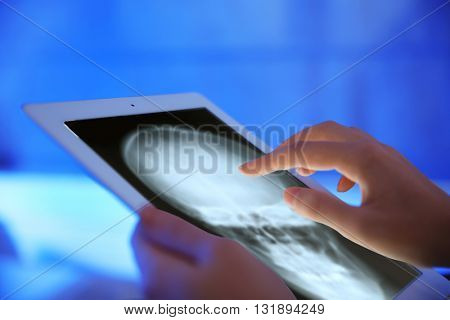 Doctor working with tablet-pc, close up