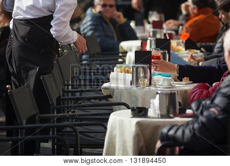 TRIESTE ITALY - APRIL 28: Tourists sitting in the outdoor coffee bar on April 28 2016