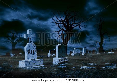 Graveyard on moonlit night with cracked tombstones clouds fog and spooky trees. Copy space.