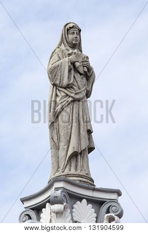 Statue in the courtyard of the old catholic church of the Basilica del Santo Nino. Cebu Philippines. poster