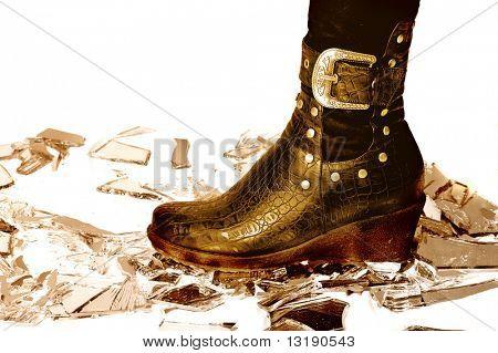Leather boot on broken mirror