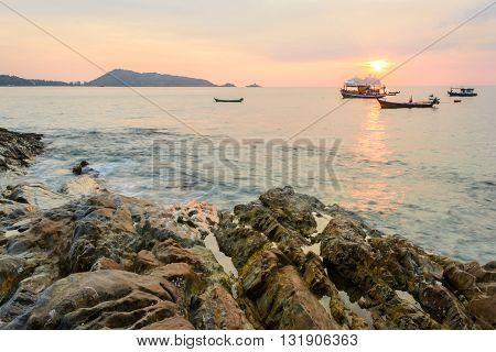Long Exposure of Sunset and rock at Kalim beach Phuket Thailand