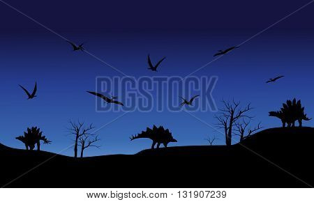 Silhouette of Pterodactyl and Stegosaurus at the night