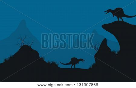 Landscape of Stegosaurus in hills at the night